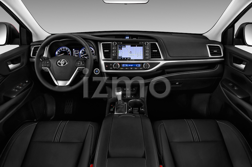Stock photo of straight dashboard view of 2018 Toyota Highlander SE 5 Door SUV Dashboard