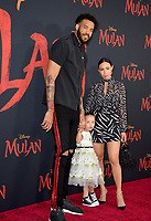 """LOS ANGELES, CA: 09, 2020: JaVale McGee, Giselle Mybelle & Daughter at the world premiere of Disney's """"Mulan"""" at the El Capitan Theatre.<br /> Picture: Paul Smith/Featureflash"""