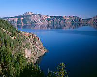 ORCL_046 - USA, Oregon, Crater Lake National Park, Conifer forest above Steel Bay on the north side of Crater Lake and distant Mount Scott.