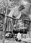 North East PA: Lake Erie Cookout, Alice Brady Stewart mixing food in the pots  - 1904. During the early 1900s, the Stewart family vacationed on Lake Erie near North East Pennsylvania. Since hotels and motels were non-existent, camping was the only viable option for a large number of vacationers
