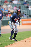 Mycal Jones (5) of the Gwinnett Braves takes his lead off of third base against the Charlotte Knights at BB&T BallPark on July 3, 2015 in Charlotte, North Carolina.  The Braves defeated the Knights 11-4 in game one of a day-night double header.  (Brian Westerholt/Four Seam Images)