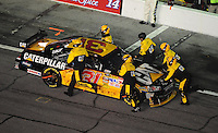 Feb 07, 2009; Daytona Beach, FL, USA; NASCAR Sprint Cup Series driver Jeff Burton is pushed back into the garage after breaking during the Bud Shootout at Daytona International Speedway. Mandatory Credit: Mark J. Rebilas-