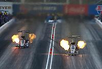 Feb 20, 2015; Chandler, AZ, USA; NHRA top fuel driver Tony Schumacher (right) races alongside Larry Dixon during qualifying for the Carquest Nationals at Wild Horse Pass Motorsports Park. Mandatory Credit: Mark J. Rebilas-
