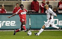 Chicago Fire forward Patrick Nyarko (14) beats Real Salt Lake midfielder Clint Mathis (84) to the ball.  Real Salt Lake defeated the Chicago Fire in a penalty kick shootout 0-0 (5-4 PK) in the Eastern Conference Final at Toyota Park in Bridgeview, IL on November 14, 2009.