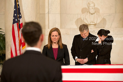 A woman cries as friends and staff of the United States Supreme Court attend a private ceremony in the Great Hall of the US Supreme Court where late Supreme Court Justice Antonin Scalia lies in repose in Washington, DC on Friday, February 19, 2016. <br /> Credit: Jacquelyn Martin / Pool via CNP