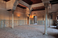 The Mexuar, meeting room for Council of Ministers and public reception room of the Sultan, Alhambra, Granada, Andalusia, Southern Spain. The room has tile decoration on the lower walls and stucco work above, with 4 columns around the central area. The Alhambra was begun in the 11th century as a castle, and in the 13th and 14th centuries served as the royal palace of the Nasrid sultans. The huge complex contains the Alcazaba, Nasrid palaces, gardens and Generalife. Granada was listed as a UNESCO World Heritage Site in 1984. Picture by Manuel Cohen