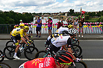 The peloton including Yellow Jersey Chris Froome (GBR) team Sky cross over the River Dordogne during Stage 10 of the 104th edition of the Tour de France 2017, running 178km from Perigueux to Bergerac, France. 11th July 2017.<br /> Picture: ASO/Pauline Ballet | Cyclefile<br /> <br /> <br /> All photos usage must carry mandatory copyright credit (&copy; Cyclefile | ASO/Pauline Ballet)
