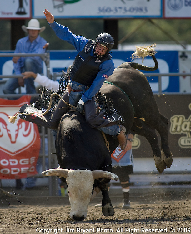 B.J. Schumacher, from Hillsboro, WI. tries to hang onto Transformer during the Xtreme Bull Riding Competition at the Kitsap County Fair and Stampede  held Aug. 26 to Aug. 30, 2009 in Silverdale, WA. Jim Bryant Photo. All Right Reserved. © 2009
