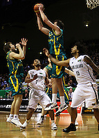 Boomers forward Joe Ingles takes a rebound as (from left) Matthew Delladova, Mike Vukona and BJ Anthony look on during the International basketball match between the NZ Tall Blacks and Australian Boomers at TSB Bank Arena, Wellington, New Zealand on 25 August 2009. Photo: Dave Lintott / lintottphoto.co.nz