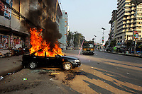 A car set on fire by activists of Bangladesh' main opposition group, the Bangladesh Nationalist Party, (BNP) goes up in flames after they clashed with police in Dhaka, Bangladesh.