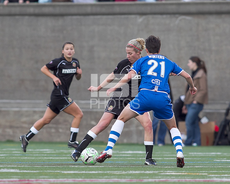 Western New York Flash midfielder Becky Edwards (14) dribbles. In a Women's Professional Soccer (WPS) match, the Western New York Flash defeated the Boston Breakers, 2-1, at Harvard Stadium on April 17, 2011.