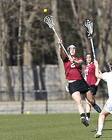 Harvard University midfielder Isabella Wager (2) passes the ball.