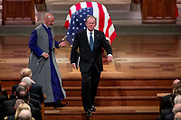 An emotional former President George Bush, sniffs after touching the flag-draped casket of his father, former President George H.W. Bush, during his State Funeral at the National Cathedral, Wednesday, Dec. 5, 2018, in Washington. <br /> Credit: Andrew Harnik / Pool via CNP / MediaPunch