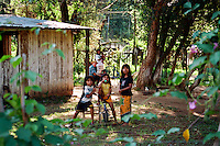 Maka Indian family with children. Maka Indigenous communities impacted by timber industry in the north. Asuncion area, Paraguay.