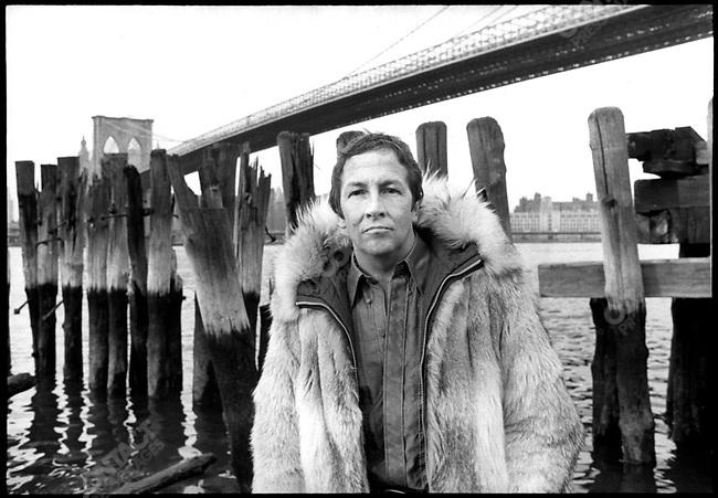 Robert Rauschenberg, artist, near Brooklyn Bridge, 1969