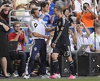 MLS All-Stars head coach Ben Olsen greets midfielder David Beckham (23) when he comes out of the game. The MLS All Stars Team defeated Chelsea FC 3-2 at PPL Park Stadium, Wednesday 25, 2012.
