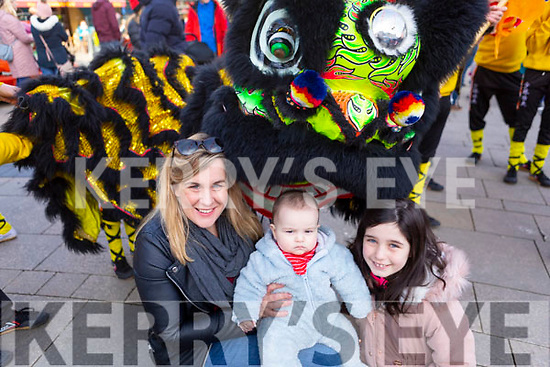 Jennifer O'Carroll Reidy, baby Oisin and Hannah Reidy from Tralee up close with the fire Dragon at the Lion & Dragon Ritual for the Chinese New Year celebrations in the square in Tralee on Saturday.