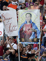 """Calcio, Serie A: Roma vs Bologna. Roma, stadio Olimpico, 16 settembre 2012..An AS Roma fan holds a banner portraying AS Roma coach Zdenek Zeman, of Czech Republic, depicted as Jesus, and reading """"It doesn't care how much you run, but where and why you run"""" prior to the start of the Italian Serie A football match between AS Roma and Bologna at Rome's Olympic stadium, 16 september 2012..UPDATE IMAGES PRESS/Riccardo De Luca"""
