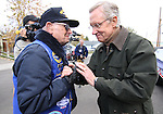 "Senate Majority Leader Harry Reid talks with Navy veteran Jim ""Smokey"" Jordan before the Nevada Day parade on Saturday, Oct. 30, 2010, in Carson City, Nev. .Photo by Cathleen Allisonz"