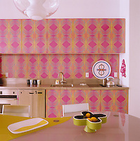 The kitchen cabinets and splashback are covered in a laminated eye-popping computer-generated 'digi-pop' print