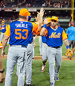 New York Mets shortstop Asdrubal Cabrera (13), right, celebrates his team's victory over the Washington Nationals at Nationals Park in Washington, D.C. on Friday, August 25 2017.  The Mets won the game 4 - 2.  At left is third base coach Glenn Sherlock (53).<br /> Credit: Ron Sachs / CNP<br /> (RESTRICTION: NO New York or New Jersey Newspapers or newspapers within a 75 mile radius of New York City)