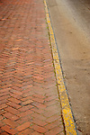 Savannah, GA.  Brick sidewalk and yellow curb.