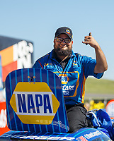 May 21, 2017; Topeka, KS, USA; Crew member for NHRA funny car driver Ron Capps celebrates after winning his fourth straight victory following the Heartland Nationals at Heartland Park Topeka. Mandatory Credit: Mark J. Rebilas-USA TODAY Sports