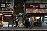 salarymen smoke and drink alcohol in a small street in Yurakucho, Tokyo, Japan. Friday May29th 2015