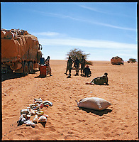 Sahara desert, Chad, December 2004..Every week, a convoy of 40 privately owned Libyan trucks loaded by the WFP with about 1000 metric tons of western food aid cross 2500 km of deep desert across Libya and Chad to reach more than 200 000 refugees from Darfur in camps near the Sudanese border. A rogue unit of the Chad Army has stopped the convoy, it will take more than 12 hours of discussions ans some 'presents' (food, gasoline, water...) for them to finally release the trucks...