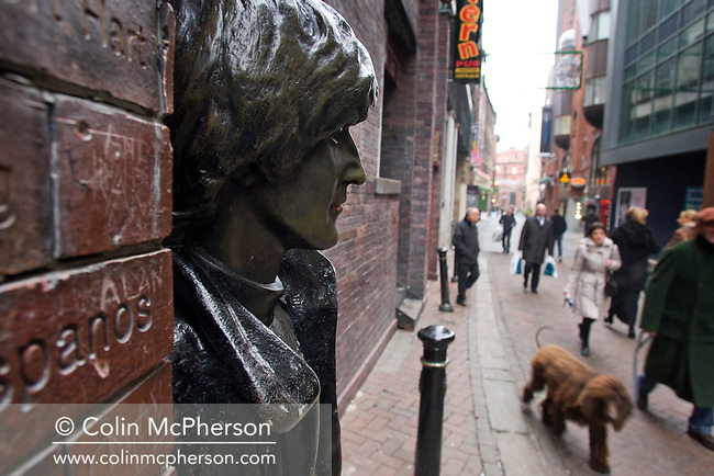 A statue of John Lennon in Matthew Street, outside the Cavern Club in Liverpool. The city was the birthplace of the Beatles and the Merseybeat scene of the 1960s. Many of the original venues still survive as does a thriving modern music scene with the city being 2008 European Capital of Culture.