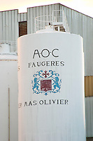 Mas Olivier. Faugeres. Languedoc. Painted steel vats. France. Europe.