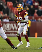 Washington Redskins quarterback Josh Johnson (8) looks for a receiver in fourth quarter action against the New York Giants at FedEx Field in Landover, Maryland on Sunday, December 9, 2018.  The Giants won the game 40 - 16.<br /> Credit: Ron Sachs / CNP<br /> (RESTRICTION: NO New York or New Jersey Newspapers or newspapers within a 75 mile radius of New York City)
