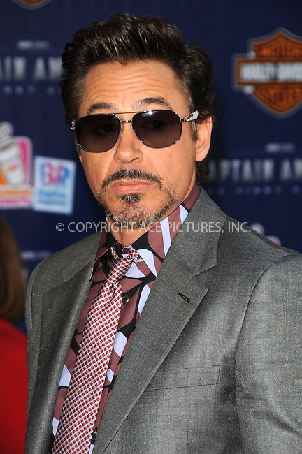 WWW.ACEPIXS.COM . . . . .  ....July 19 2011, LA....Robert Downey Jr. arriving at the 'Captain America: The First Avenger' Los Angeles Premiere at the El Capitan Theater on July 19, 2011 in Hollywood, California.....Please byline: PETER WEST - ACE PICTURES.... *** ***..Ace Pictures, Inc:  ..Philip Vaughan (212) 243-8787 or (646) 679 0430..e-mail: info@acepixs.com..web: http://www.acepixs.com