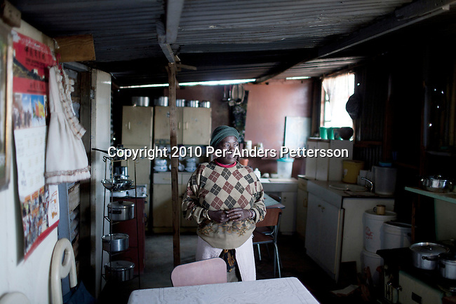 SOWETO, SOUTH AFRICA - APRIL 28: Titi Khambule, age 48, and unemployed woman, stands inside her shack on April 28, 2010, in the Motswaledi section of Soweto, South Africa. Soweto is the largest township in South Africa, located about 10 kilometers southwest of downtown Johannesburg. The population is estimated to be around 2-3 million. A growing black middle class can be seen in the township and many shopping malls and has been built the last few years. (Photo by Per-Anders Pettersson)