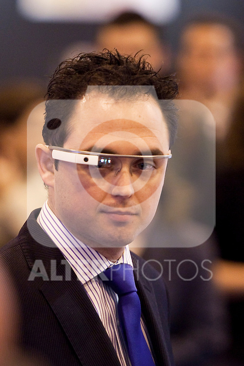 A man wears the new google glass during the 'Fitur' International Tourism Fair opening at Ifema in Madrid, Spain. January 22, 2014. (ALTERPHOTOS/Victor Blanco)