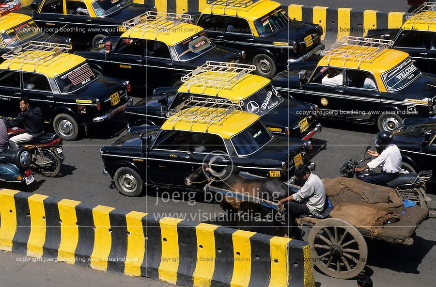 INDIA Mumbai, premier taxi and bullock cart on the road in front of VT station / INDIEN Mumbai Bombay , Strassenverkehr mit Taxi und Ochsenkarren am Victoria terminus Bahnhof