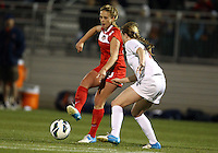 BOYDS, MARYLAND - April 06, 2013:  Caroline Miller (10) of The Washington Spirit passes in front of Emily Sonnett(16) of the University of Virginia women's soccer team in a NWSL (National Women's Soccer League) pre season exhibition game at Maryland Soccerplex in Boyds, Maryland on April 06. Virginia won 6-3.