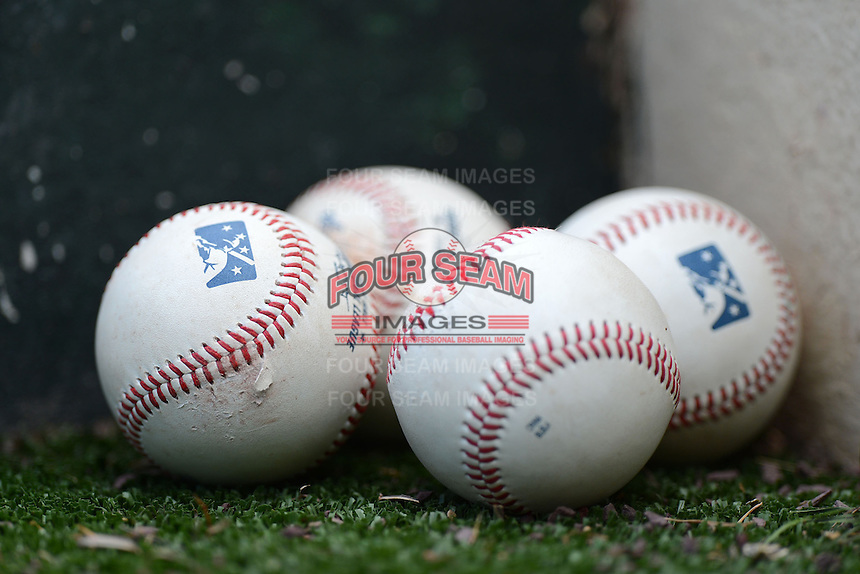 Baseballs on the dugout steps during a game between the Columbus Clippers and Rochester Red Wings on May 12, 2013 at Frontier Field in Rochester, New York.  Rochester defeated Columbus 5-4.  (Mike Janes/Four Seam Images)