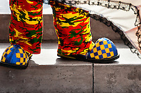 A clown wears oversized blue and yellow shoes and colorful camouflage pants during the Clown Congress in San Salvador, El Salvador, 18 May 2011. The clown performance is considered a regular job in most of Latin American countries. Clowns may work individually or in groups, often performing advertisement like acts in large open-to-street shops or they take part in private shows, like children birthdays, family events etc. There are many clown conventions all over Latin America where clowns gather and exchange their experiences offering workshops of the comic acting or the art of make-up. For some of them, being clown is a serious lifetime profession.
