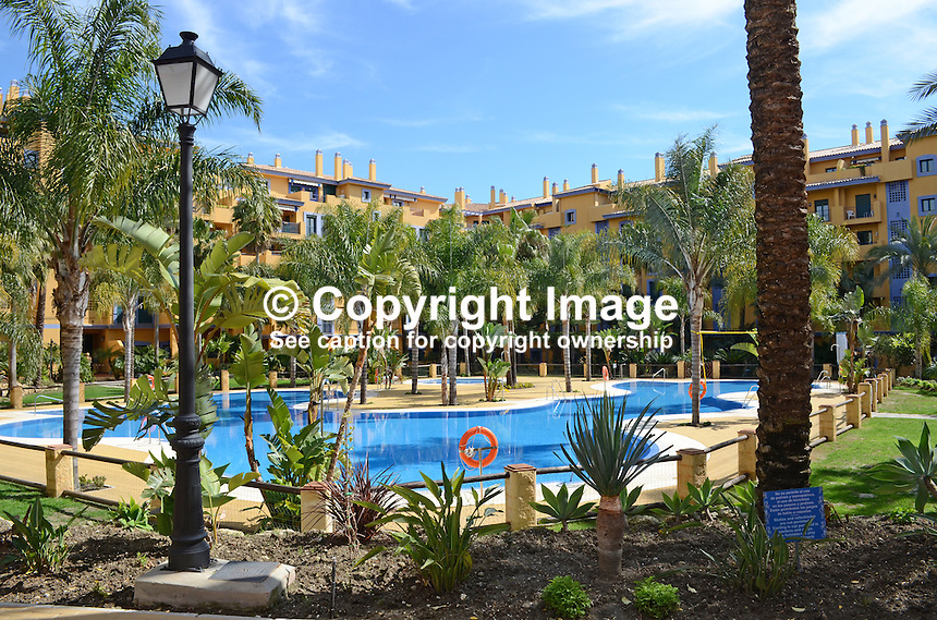 Swimming pool, apartment complex, Los Jazmines, San Pedro de Alcantara, Malaga Province, Spain, 201302241177..Copyright Image from Victor Patterson, 54 Dorchester Park, Belfast, UK, BT9 6RJ..Tel: +44 28 9066 1296.Mob: +44 7802 353836.Voicemail +44 20 8816 7153.Skype: victorpattersonbelfast.Email: victorpatterson@me.com.Email: victorpatterson@ireland.com (back-up)..IMPORTANT: If you wish to use this image or any other of my images please go to www.victorpatterson.com and click on the Terms & Conditions. Then contact me by email or phone with the reference number(s) of the image(s) concerned.