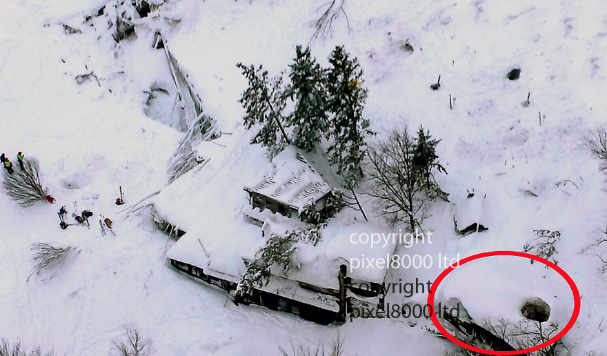 Pic shows: Helicopter shot of the remote, four-storey Hotel Rigopiano in the town of Farindola in the central Abruzzo region<br /> <br /> Part of the hotel ,circled, was moved 10 metres from its foundations.<br /> <br /> Up to 30 people are feared to have died after an avalanche believed to have been triggered by an earthquake hit a spa hotel in Italy.<br /> <br /> It buried the remote, four-storey Hotel Rigopiano in the town of Farindola in the central Abruzzo region on Wednesday night.<br /> <br /> The top floor and roof of the complex were barely visible above a thick blanket of snow on the Gran Sasso mountain.<br /> <br /> <br /> <br /> Picture by Pixel8000 07917221968