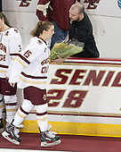 Emily Field (BC - 15), Andrew Zagorianakos (BC - Assistant Manager) -  The Boston College Eagles defeated the visiting Boston University Terriers 5-0 on BC's senior night on Thursday, February 19, 2015, at Kelley Rink in Conte Forum in Chestnut Hill, Massachusetts.