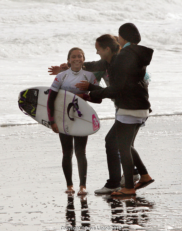 NZ's Sarah Mason is congratulated by ffiends after beating Stephanie Gilmore in the heats on day three..ASP Pro Surf Tour - TSB Women's Surf Festival at Fitzroy Beach, New Plymouth, Taranaki, New Zealand on Thursday, 15 April 2010. Photo: Dave Lintott.