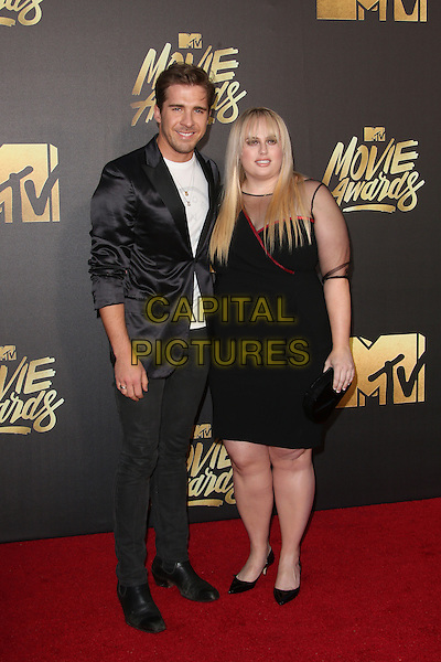 Burbank, CA - April 09 Rebel Wilson and Hugh Sheridan Attending 25th Annual MTV Movie Awards at Warner Brothers Studios On April 09, 2016. <br /> CAP/ADM/FS<br /> &copy;FS/ADM/Capital Pictures