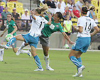 Shannon Boxx #7 of Abby's XI kicks the ball away from Kristine Lilly #13 of Marta's XI during the WPS All-Star game at KSU Stadium in Kennesaw, Georgia on June 30 2010. Marta XI won 5-2.