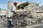 A man scavenges for metal in the devastated center of Port-au-Prince, Haiti, which was ravaged by a January 12 earthquake.