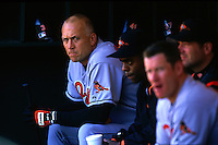 OAKLAND, CA - Cal Ripken Jr. of the Baltimore Orioles sits in the dugout during a game against the Oakland Athletics at the Oakland Coliseum in Oakland, California in 1997. Photo by Brad Mangin