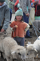 Young boy at animal market in village of Saquisili in the western Andes of Ecuador.