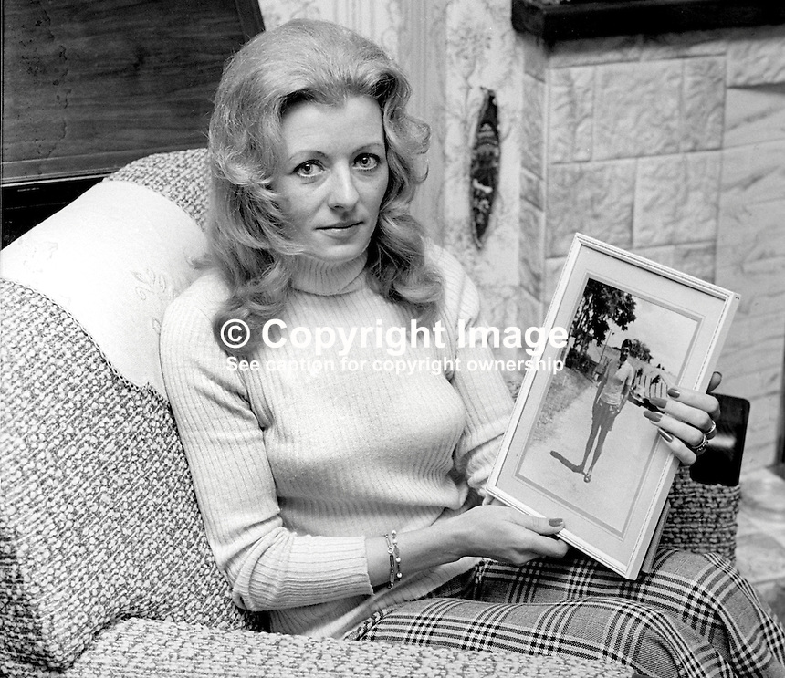 Mrs Ina Vines, widow of ATO, Army Technical Officer, Sgt Major William Ronald Vines, who died in a Provisional IRA landmine explosion near Crossmaglen, Co Armagh, N Ireland, on 5th May 1973. She is show with a framed photograph of her husband.Two other soldiers died when a second landmine exploded during a follow-up operation. 197504170374a<br /> <br /> Copyright Image from Victor Patterson, 54 Dorchester Park, Belfast, UK, BT9 6RJ<br /> <br /> Tel: +44 28 9066 1296<br /> Mob: +44 7802 353836<br /> Voicemail +44 20 8816 7153<br /> Email: victorpatterson@me.com<br /> Email: victorpatterson@gmail.com<br /> <br /> IMPORTANT: My Terms and Conditions of Business are at www.victorpatterson.com