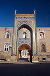 A man exits the mosque in Dushanbe, Tajikistan.